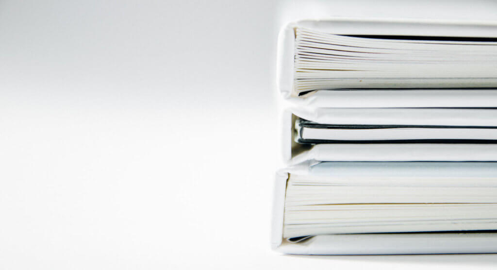 Image of a stack of white folders