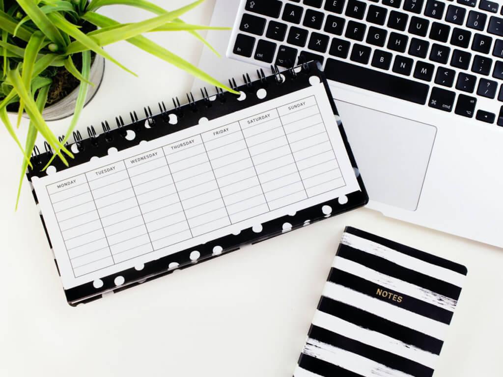 White printed calendar on laptop image
