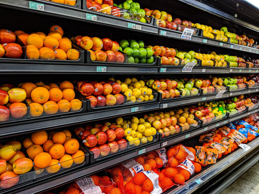 Oranges, apples, and lemons in a grocery store image
